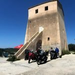 Motorcycle Group in front of a Norman tower in South of Italy