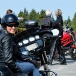 A ladies on Harley take a rest after a great ride in outstanding Tuscany