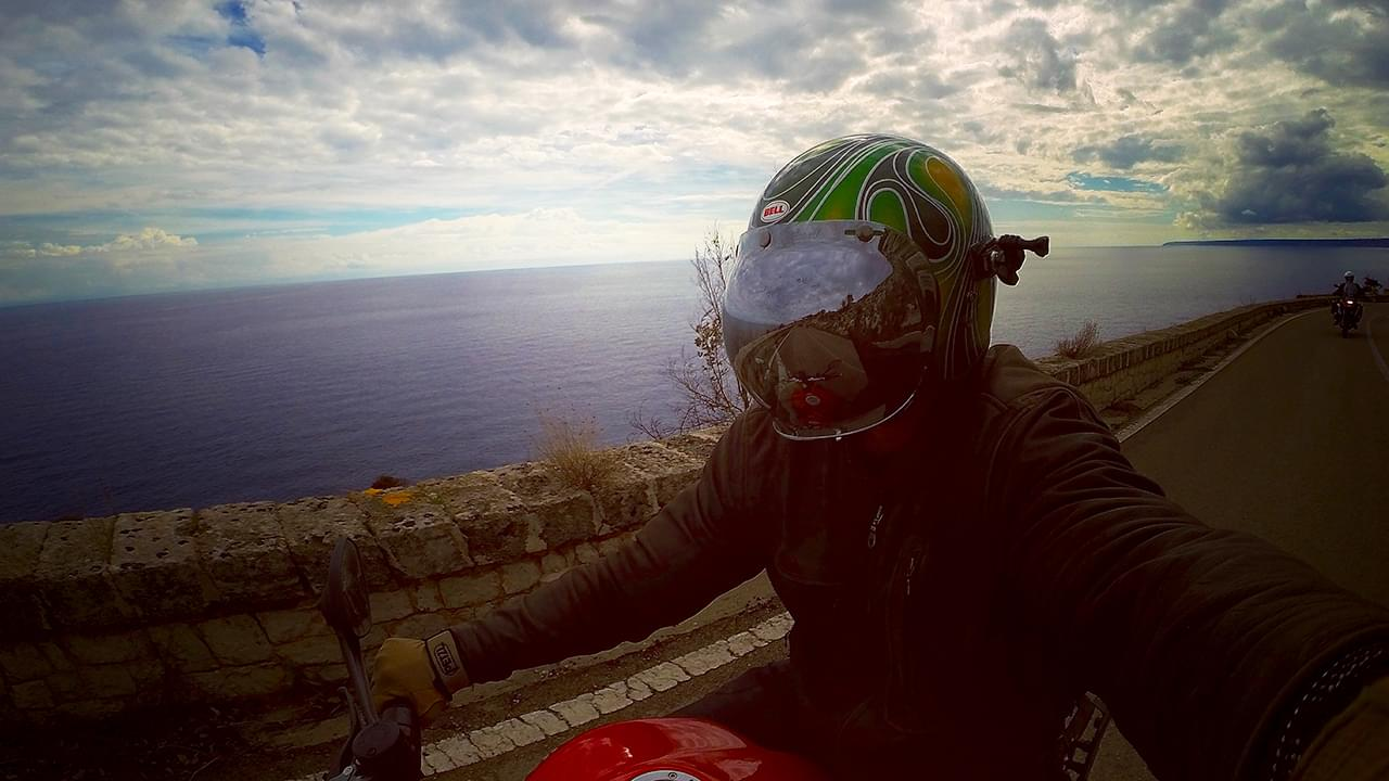 Riding in the sunset on the stunning coastline roads of Southern Italy
