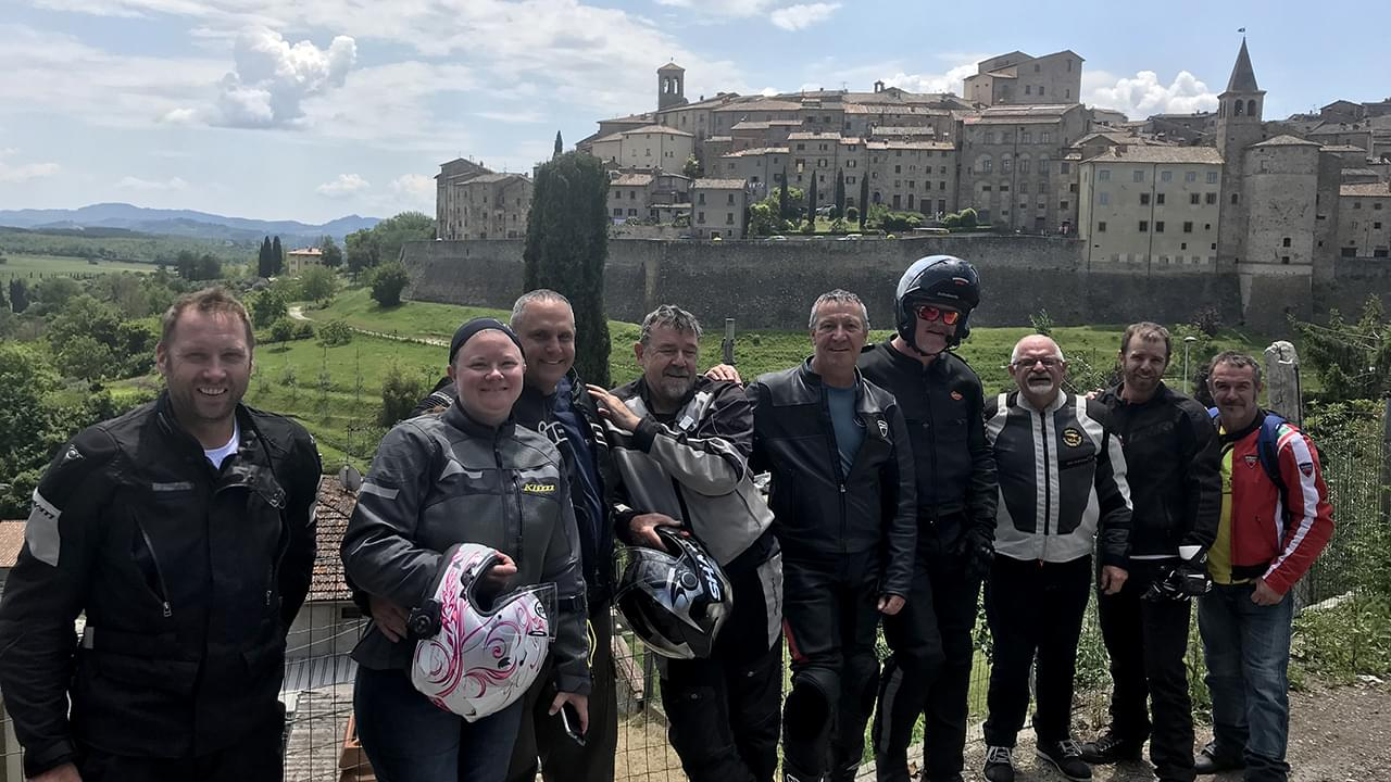 Motorcycle group in front of the walled town of Anghiari