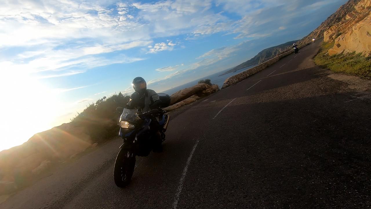 Ride the dramatic coastline roads in Corsica