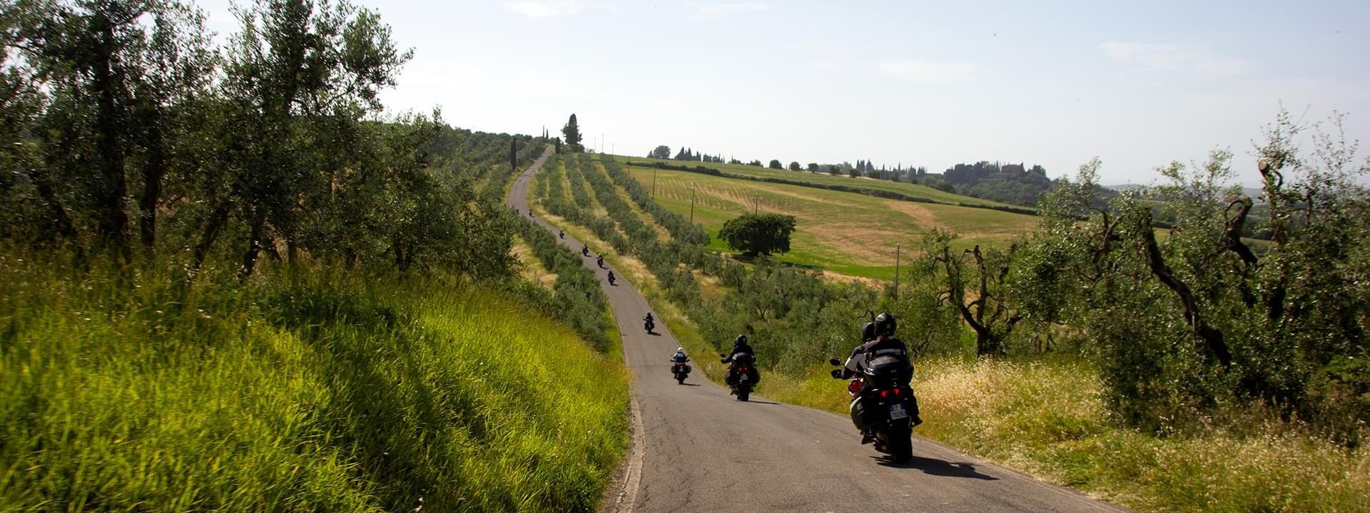 Motorcycle group ride the amazing Tuscan landscape